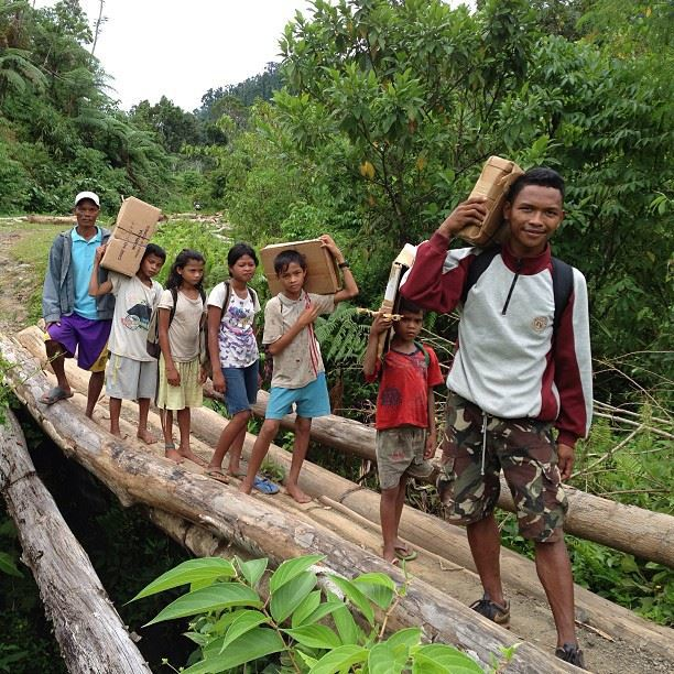 Mintosing teacher and students carrying their books