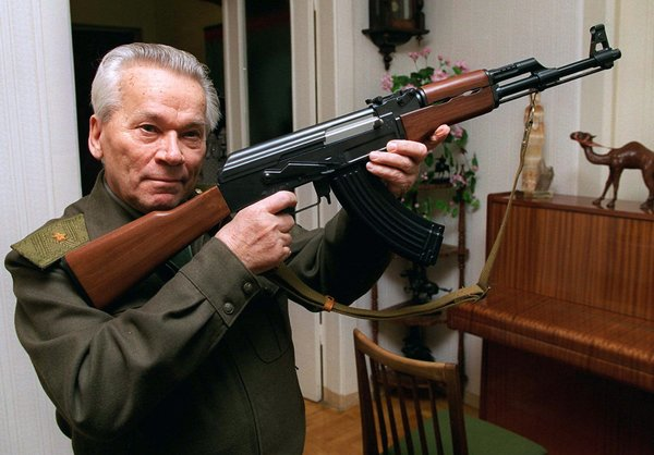 Lt. Gen. Mikhail T. Kalashnikov with a model of the AK-47 in 1997. (Vladimir Vyatkin/Associated Press)