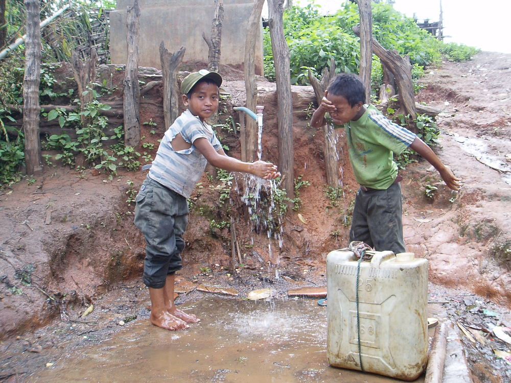 Two child soldier washing their face -Nam Yang.JPG