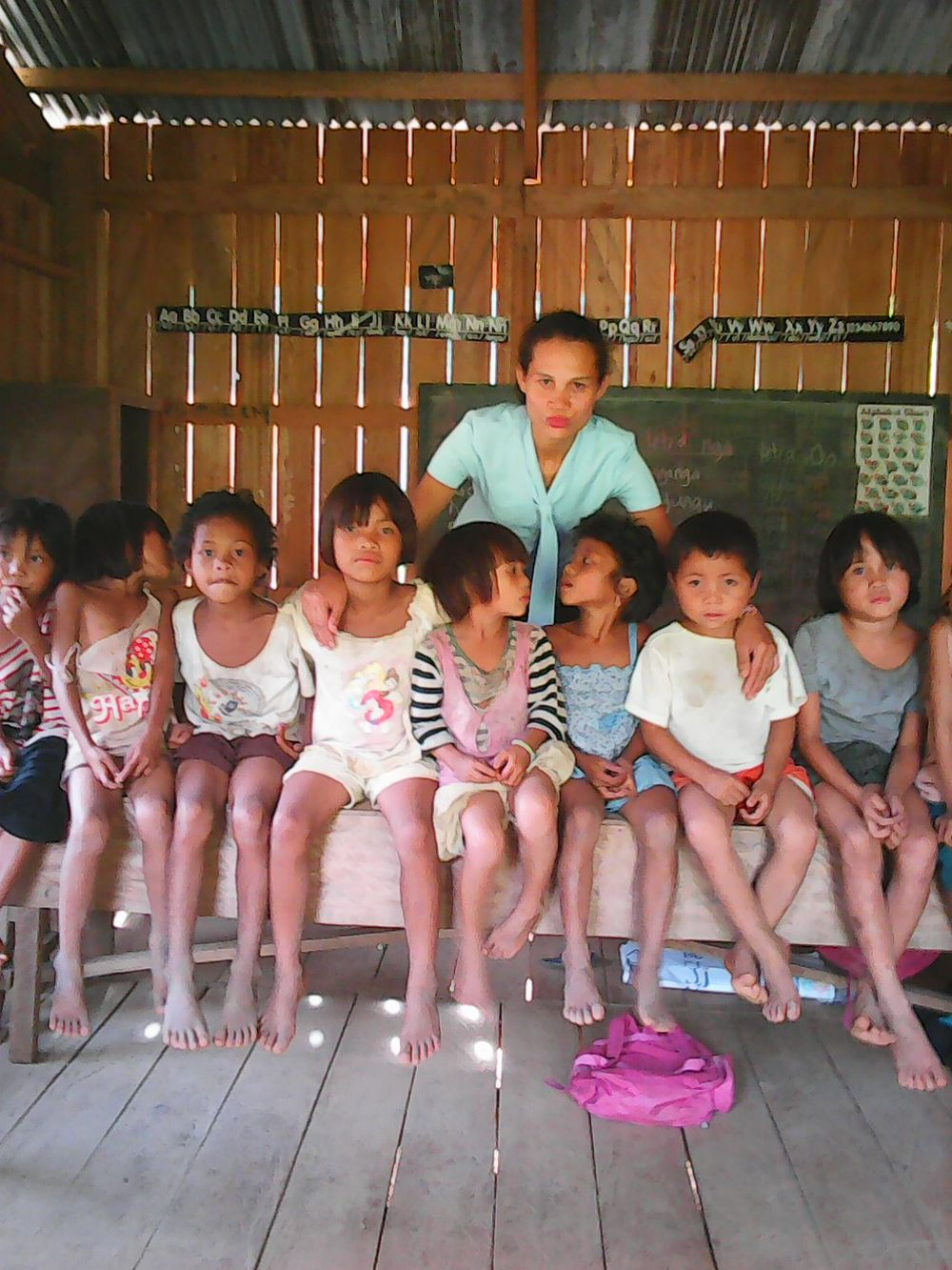 Tigbaw teacher Elsa with students.jpg