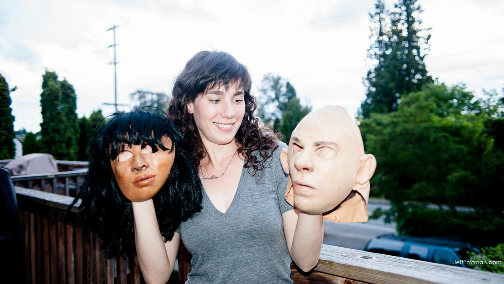 Crow Researcher Kaeli Swift holding two masks used in crow research projects in and around Seattle, Washington.