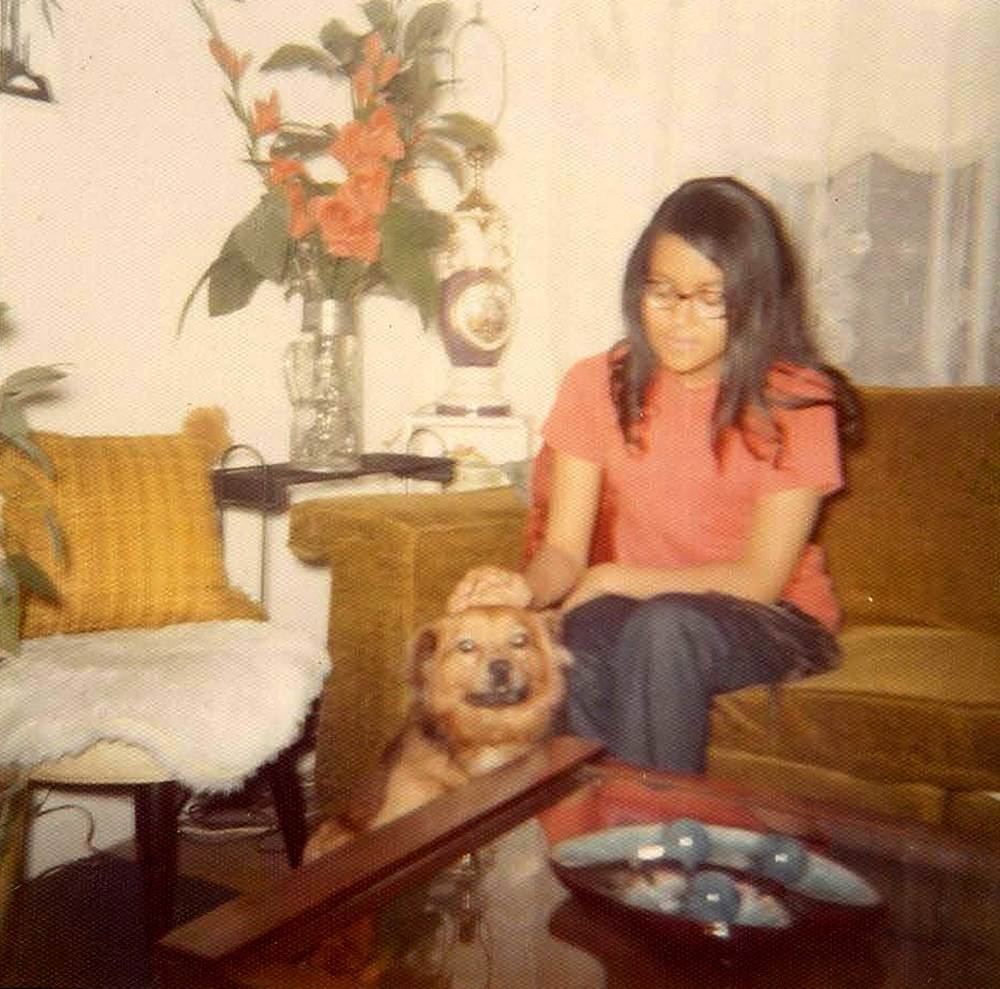 Karen petting a dog. 1970.   Photo courtesy Karen Smith.