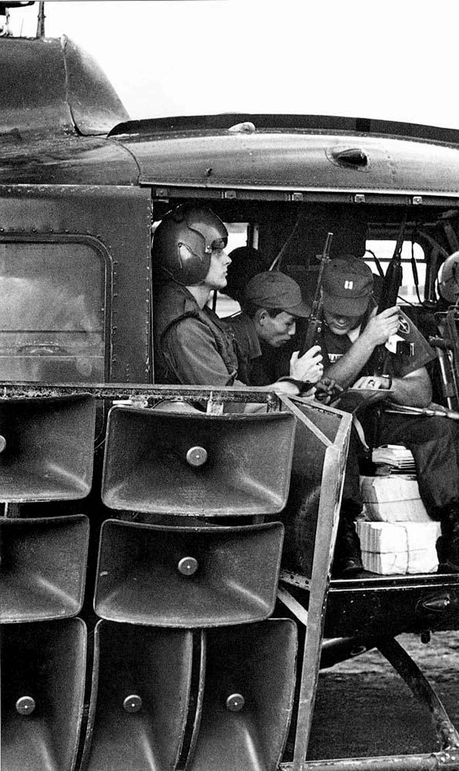propaganda mission conducted by South Vietnamese and American PSYOP soldiers. Piles of leaflets are visible near the helicopter door.Image courtesy of  http://www.psywarrior.com