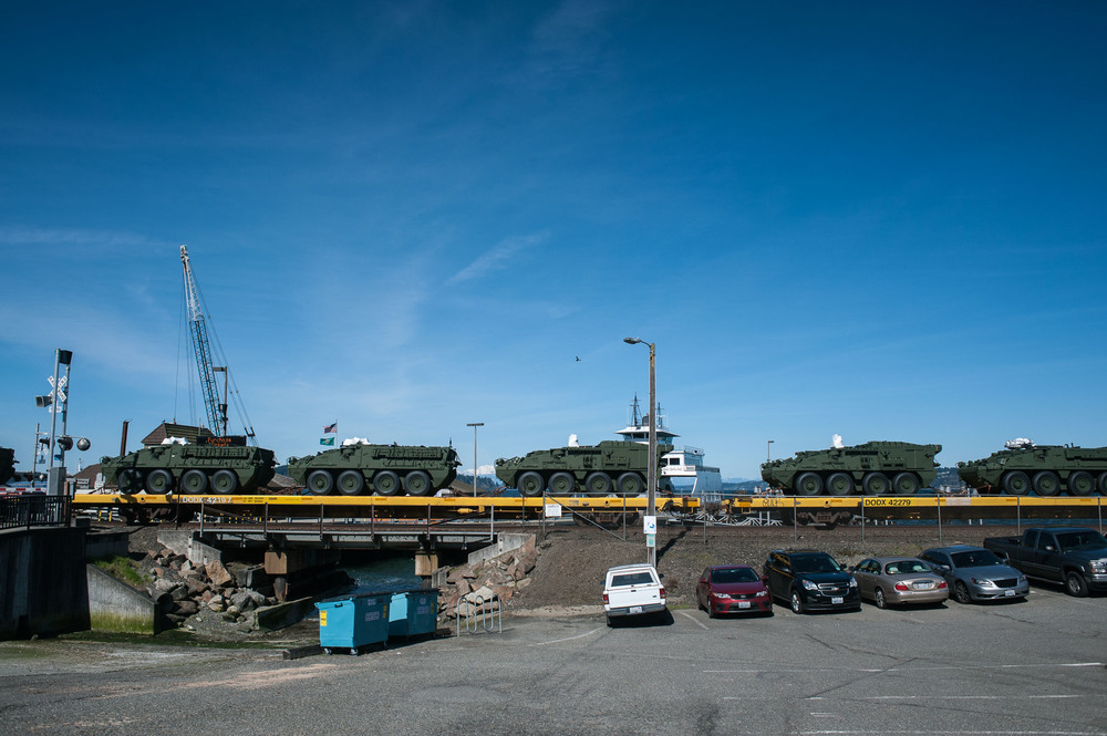 Trains regularly pass by the Steilacoom Ferry Dock.  This one carries military equipment.  Presumably, this shipment is bound for nearby Fort Lewis.