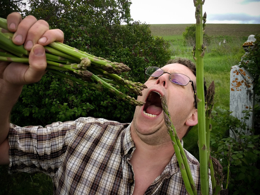 Ryan Graves pretending to eat wild asparagus