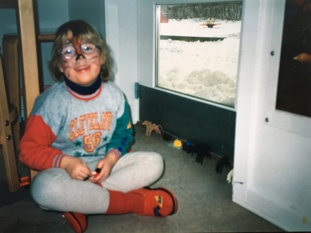 Childhood photo of Anna wearing face paint