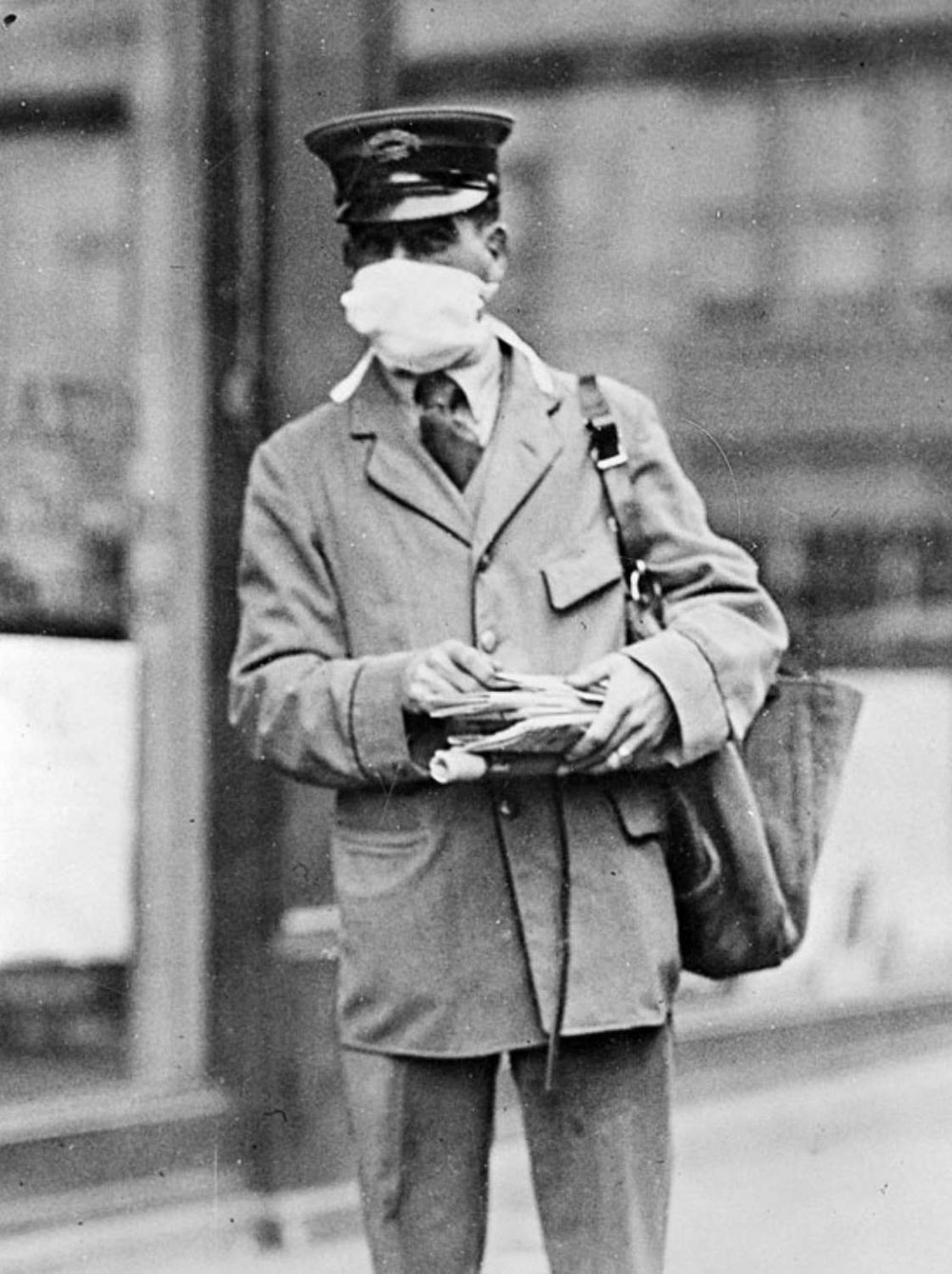 New York City letter carrier wearing mask to protect against Spanish Flu in 1918. Via  The National Archives