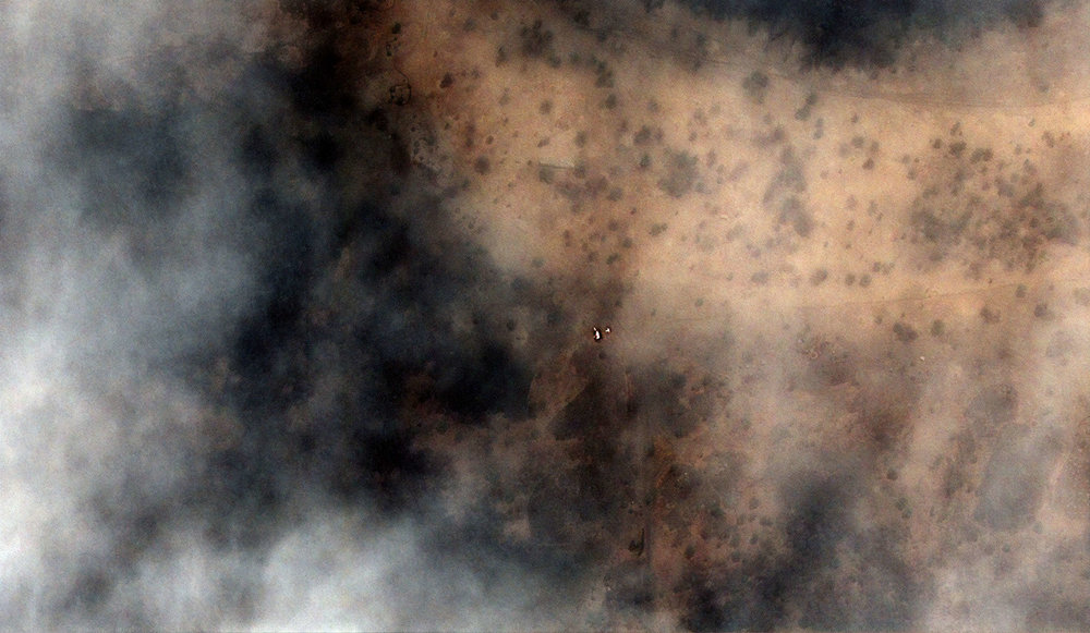Fire burning near Abyei town .  May 24, 2011. Image credit: DigitalGlobe.