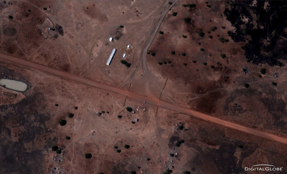 "Checkpoint with barriers north of Abyei Town on road to Diffra . January 13, 2011. From the Satellite Sentinel Project report ""Evidence of SAF Deployment in South Kordofan,"" Image credit: DigitalGlobe."