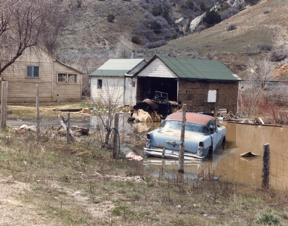 Thistle slowly being submerged by Thistle Lake in April 1983. Photo courtesy of the Utah State Archives and Records Service.