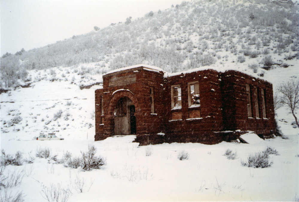 The historic Thistle school house emerges from the waters in December 1983. Photo courtesy of the Utah State Archives and Records Service.