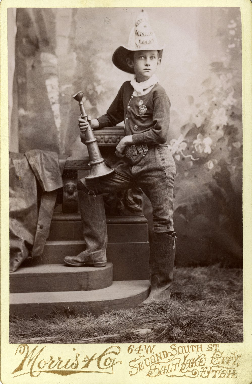 UNIDENTIFIED BOY IN FIRE FIGHTER UNIFORM (SERIES 23526). IMAGE COURTESY OF THE UTAH STATE ARCHIVES AND RECORDS SERVICE.