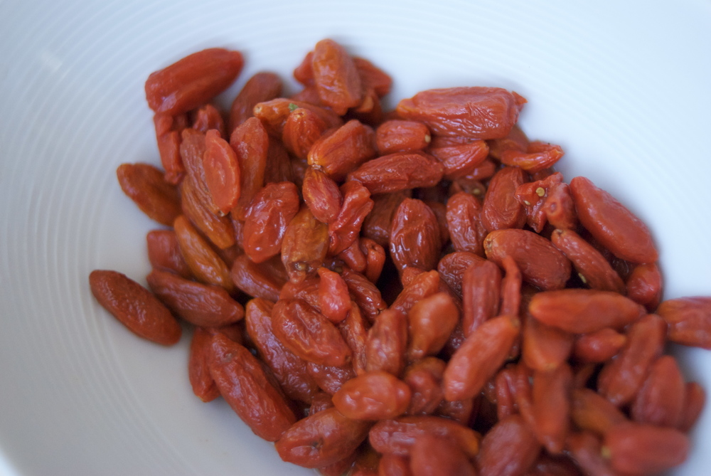 "In the West, dried goji berries (also known as wolf berries) are known for being high in antioxidants, rich in beta-carotene, thiamine, riboflavin, vitamin C, and amino acids. In the East, goji berries are used because they nourish ""yin"", enhance ""chi"", and tone the blood. Goji berries are believed to enhance the immune system, protect the liver, improve vision, deter tumors, and help eliminate fatigue. You'll see their seeds at the bottom of the soup."