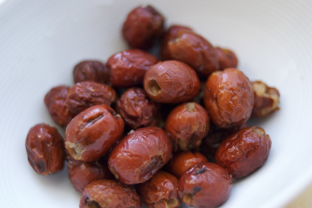 Red dates (aka jujubes or hong zao) are believed to nourish the blood. They taste like apples and can be eaten raw, dried, or boiled. Make sure to buy the dates that are pitted. Red dates make soups and teas sweeter. Red dates are known to help maintain healthy blood pressure and to assist the stomach and the spleen in poor appetites. Red dates are often used to address stress and shortness of breath. Red date teas are also traditionally used after menstruation to help circulation and nourish the blood.