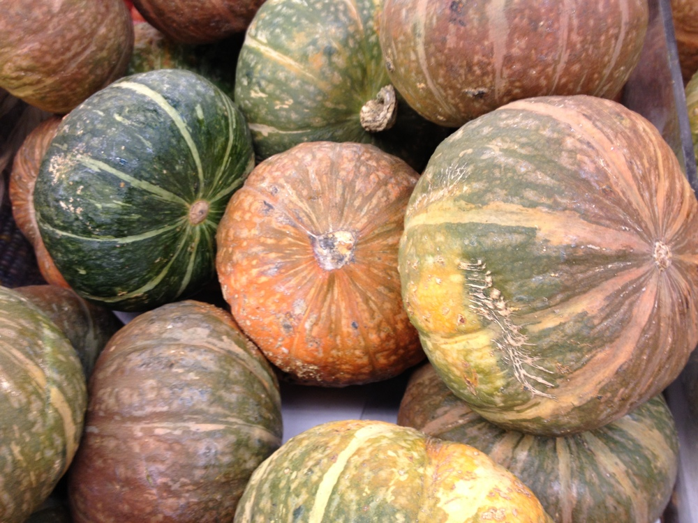The rind of kabocha can come in several different shades of green or orange. The ochre melon flesh inside is the same though.
