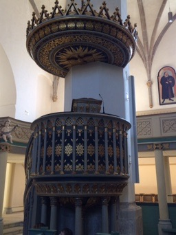 The pulpit itself is not the one Luther stood in (what is left of that one is in the Luther house museum), but the location is the same!