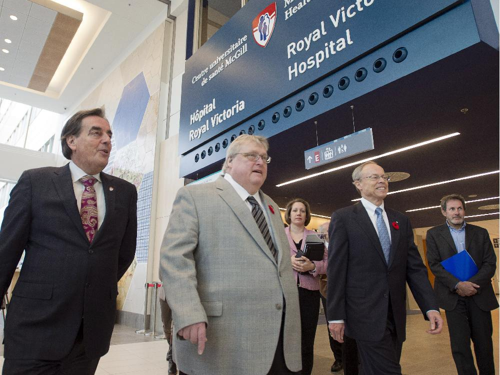 Minister Barrette (centre) tours the new Super Hospital with SNC Lavalin's Robert Card (right).  $172 million could buy a lot of psychotherapy.  Gazette photo.
