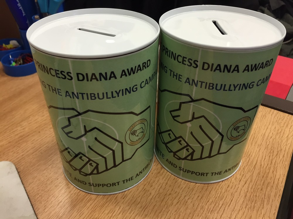 Charity tin designed by Alferton Arts College