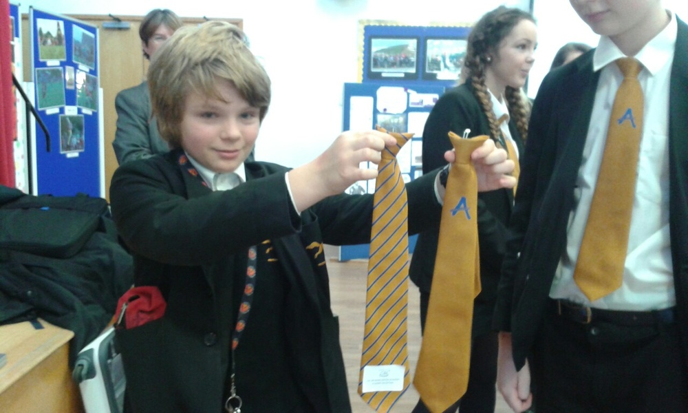 The Anti-Bullying Ambassador tie alongside The Sir John Colfox Academy tie