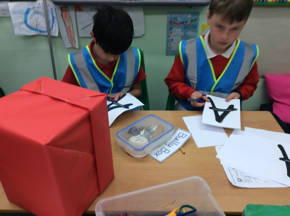 Anti-Bullying Ambassadors making their Bully & Sorry Boxes and wearing their blue hi-vis jackets