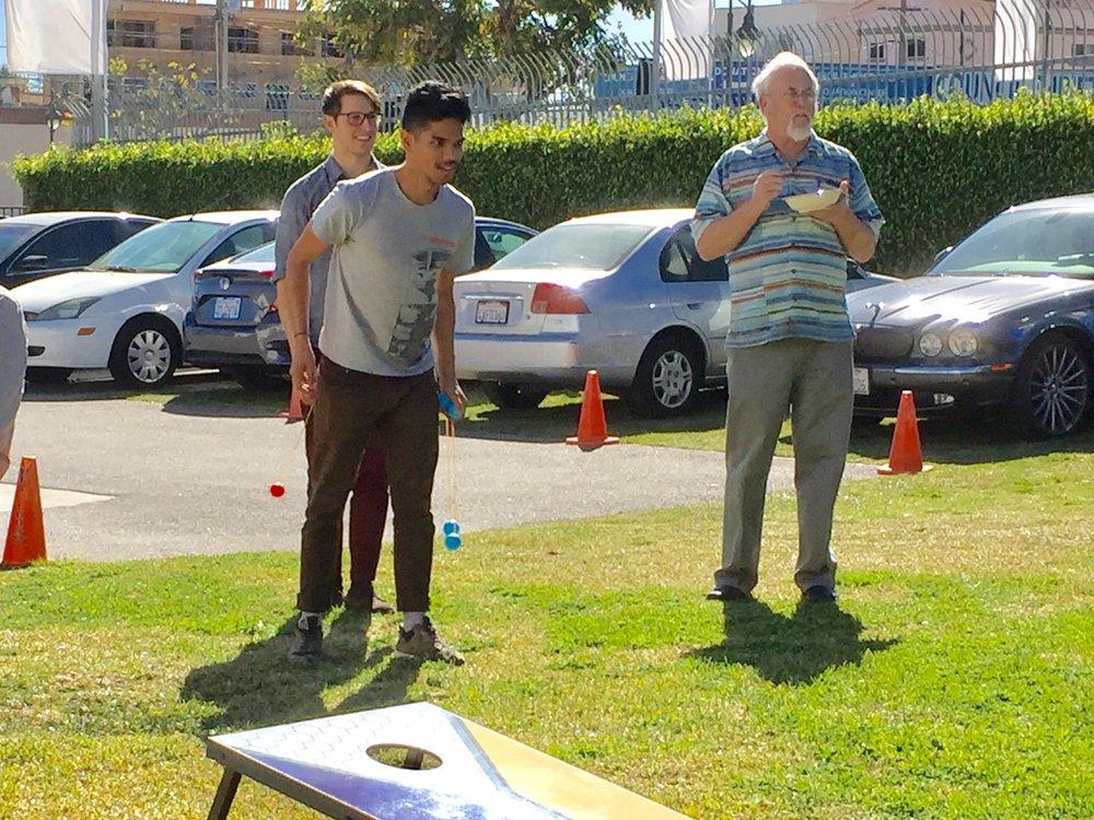 Thomas, Taj & Steve V. play lawn game.jpg