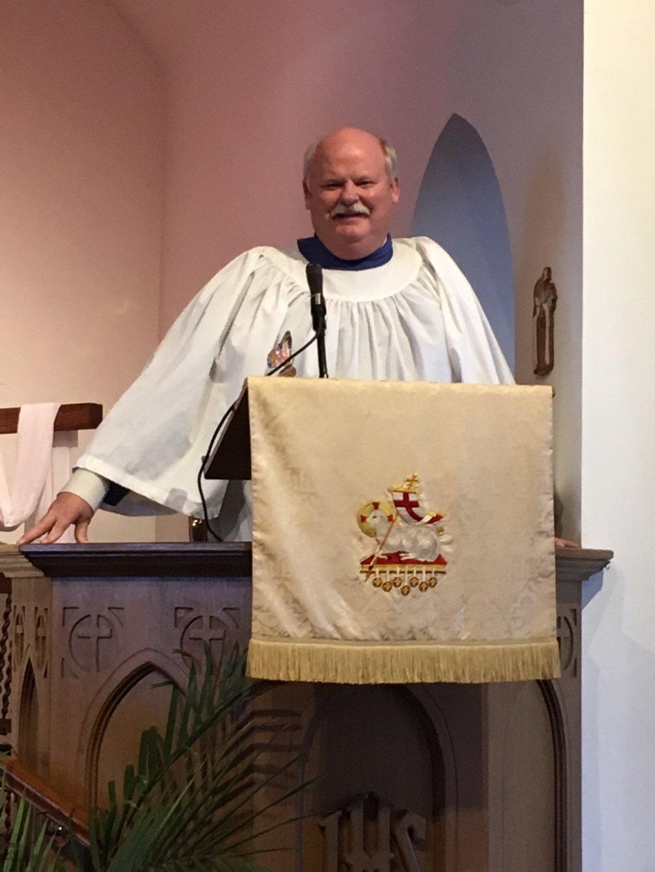 John preaches in choir robe.JPG