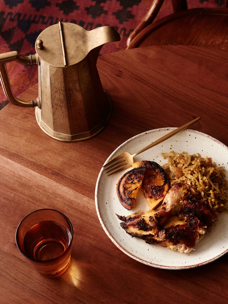 Middle Eastern stuffed chicken with freekeh and oranges. Ceramic plate by Sarah Schembri,Cutipol gold cutlery from Francalia.Recipe by Jad and Hady Choucair of Mankoushe.Styling – Lucy Feagins, styling assistant –Nat Turnbull.Photo –Eve Wilson