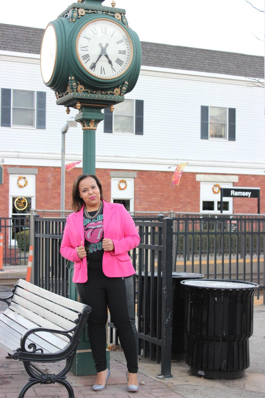 pink blazer standing by clock.jpg