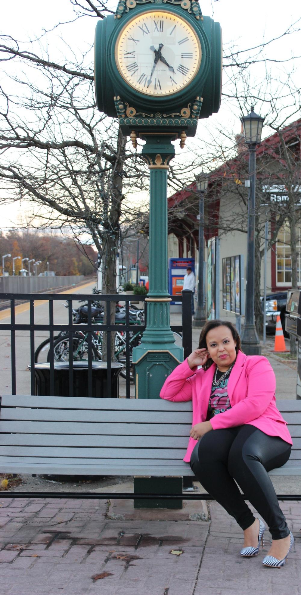 pink blazer sitting on bench.jpg