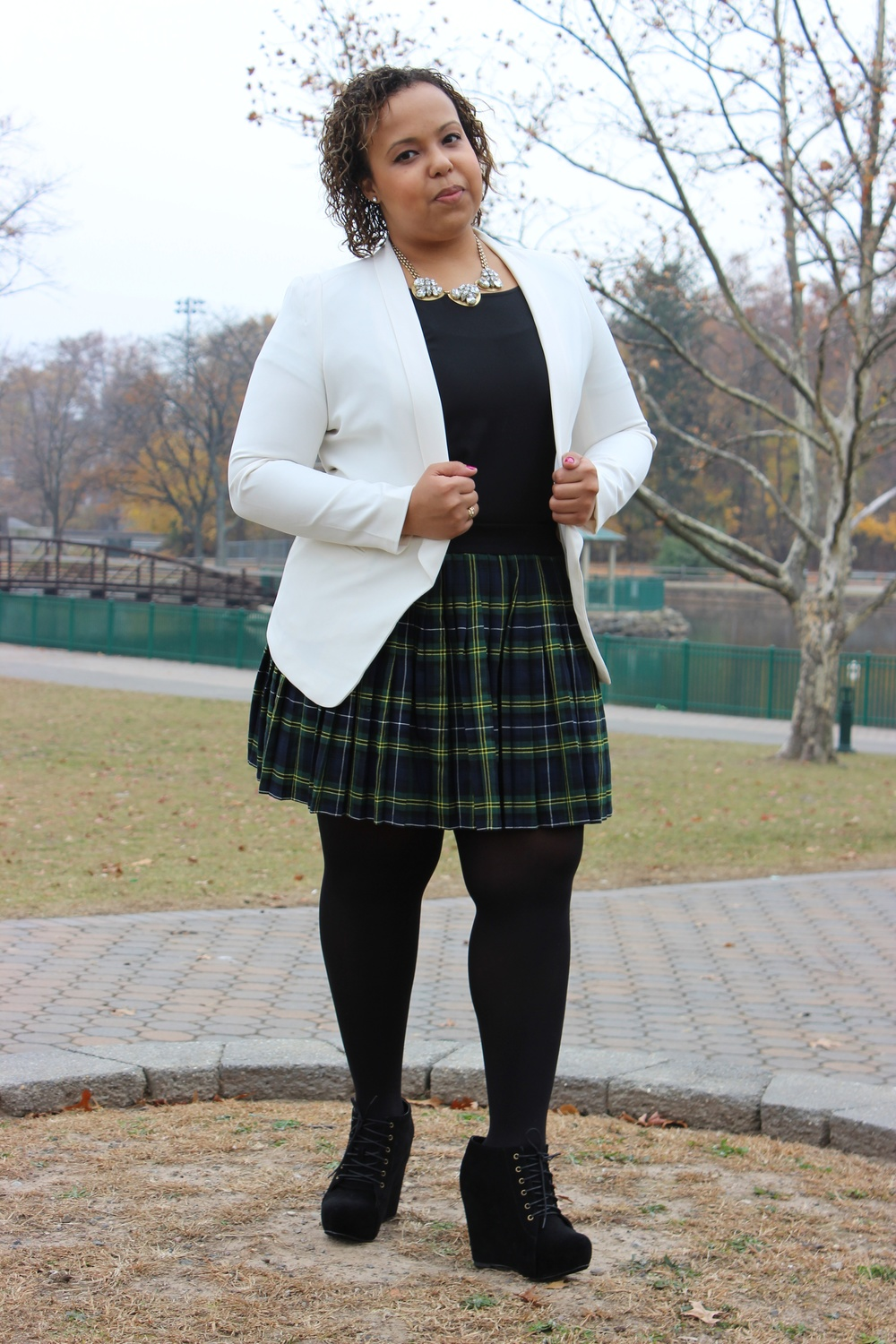 plaid skirt hands on jacket.jpg