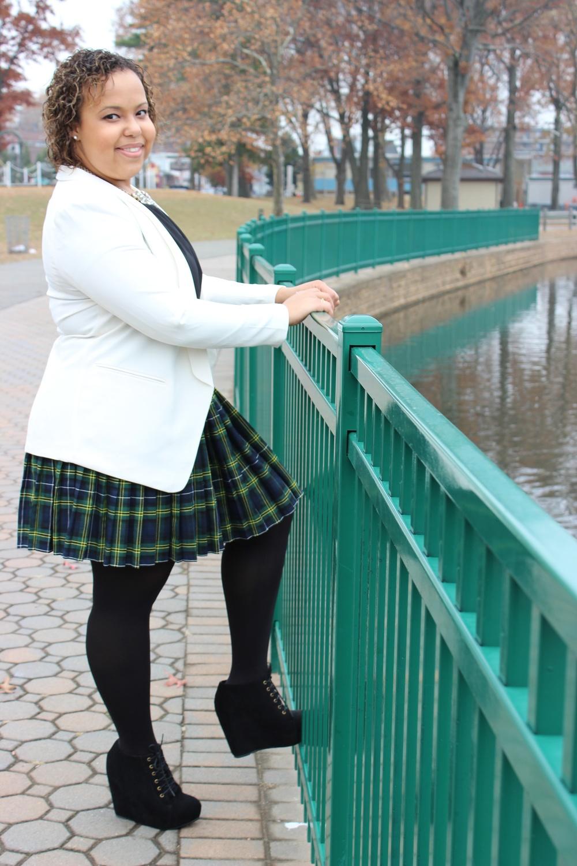 plaid skirt leg on gate.jpg