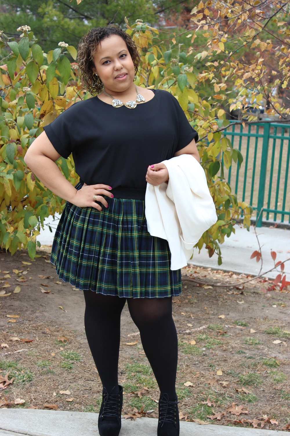 plaid skirt holding jacket.jpg