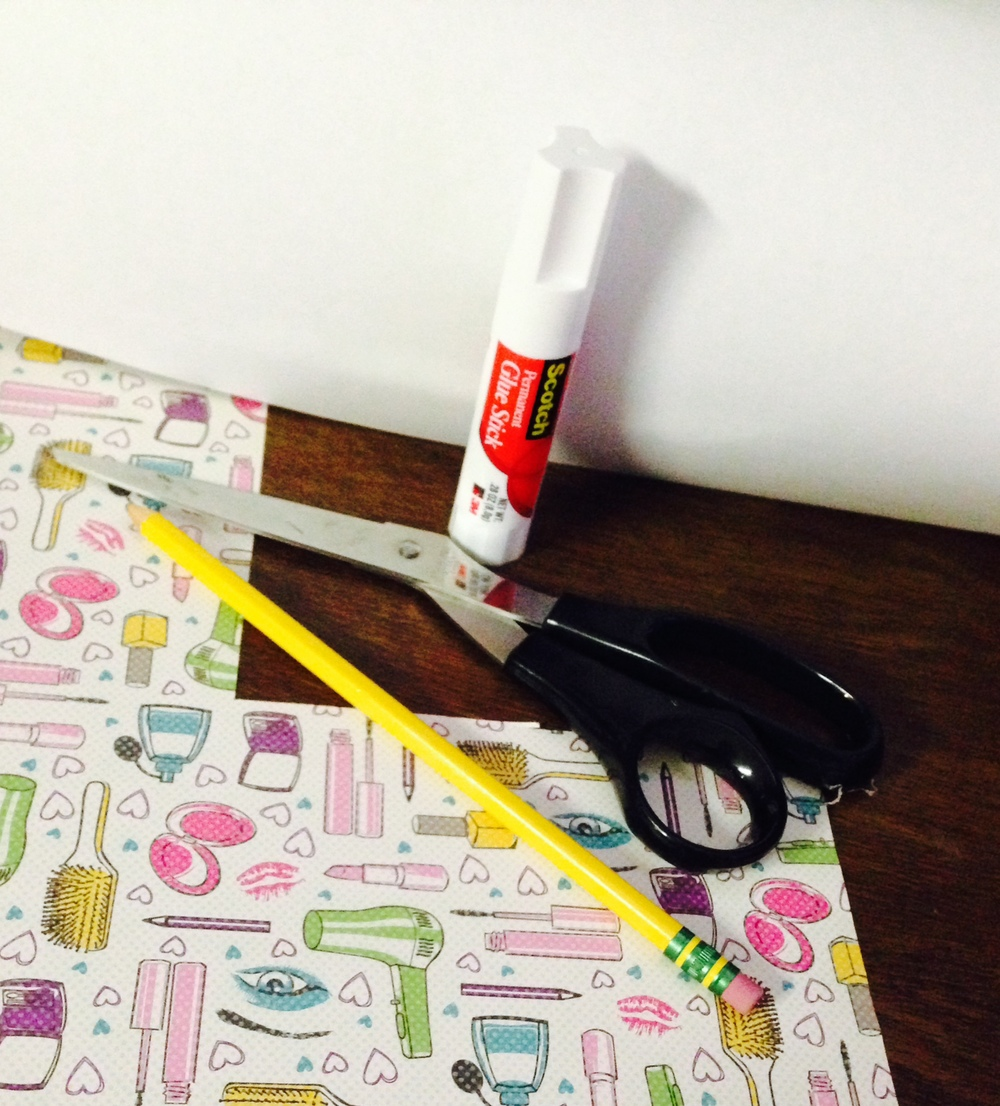 1. Supplies Needed: Glue stick, scissors, pencil, some kind of square shaped item to use as a stencil, scrapbook paper