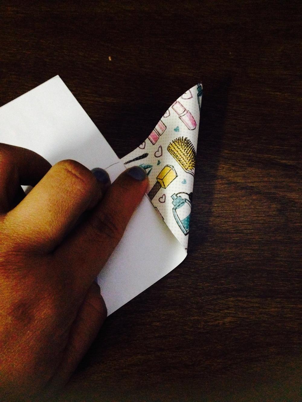 5. Fold right corner towards line