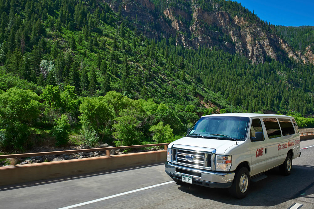 Colorado Mountain Express vehicle in Glenwood Canyon, Colorado.