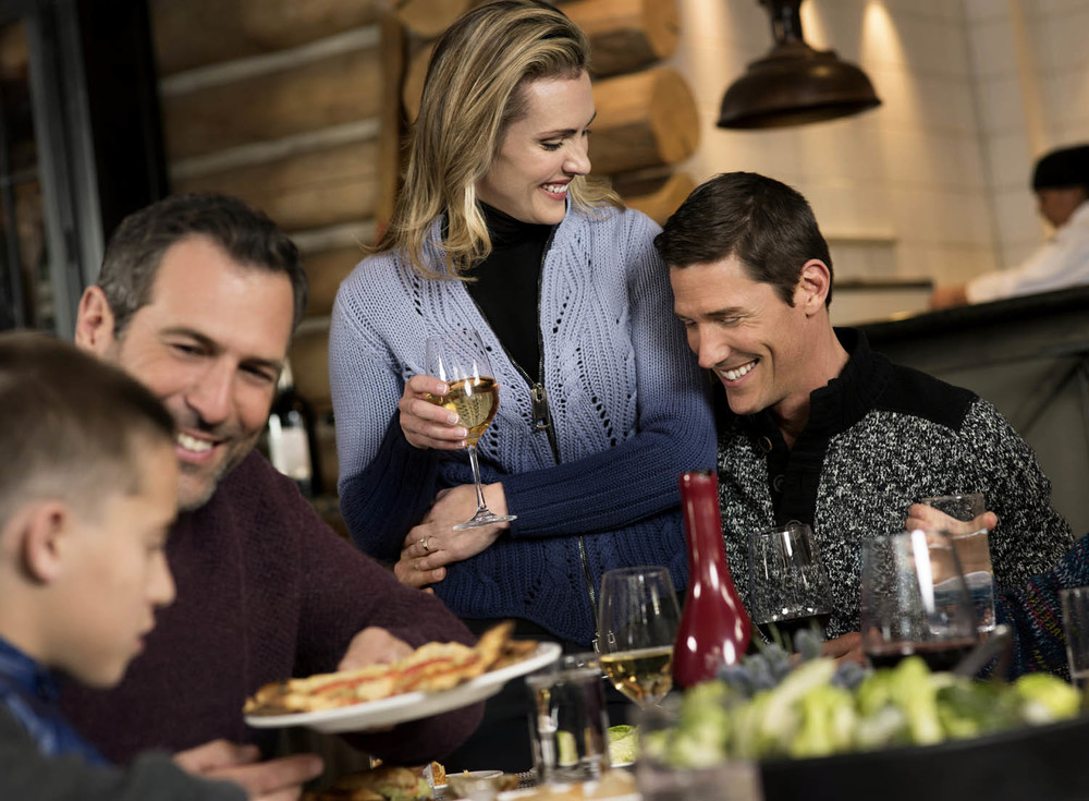 Family dining lifestyle advertising photography in Beaver Creek Colorado.