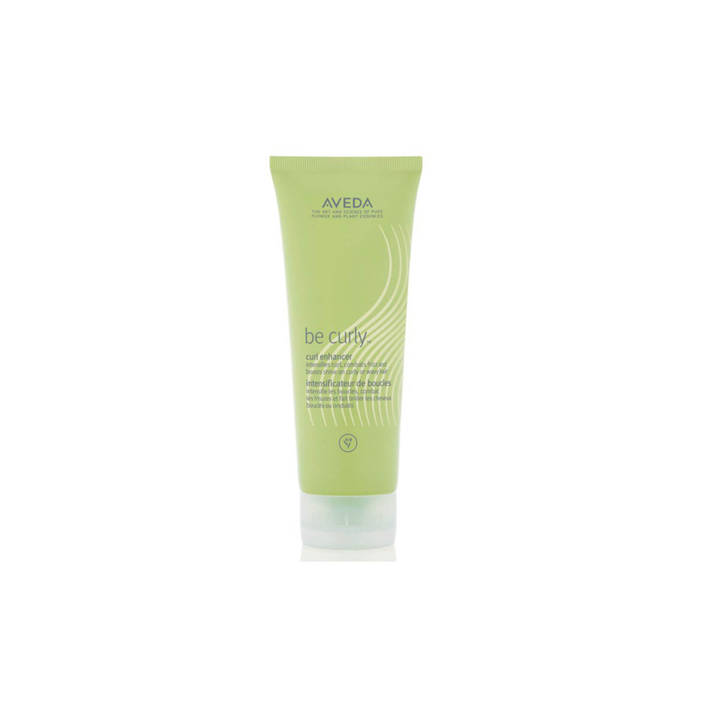 Aveda Be Curly Curl Enhancer $36.00 (200ml)   Intensifies curl, combats frizz and boosts shine on curly or wavy hair. Wheat protein and organic aloe infused styling creme expands when hair is wet and retracts when hair is dry to help intensify your curl or wave.  Aveda's own pure-fume aroma with certified organic lemon, geranium, bergamot, orange and other pure flower and plant essences.   (purchase in store only)