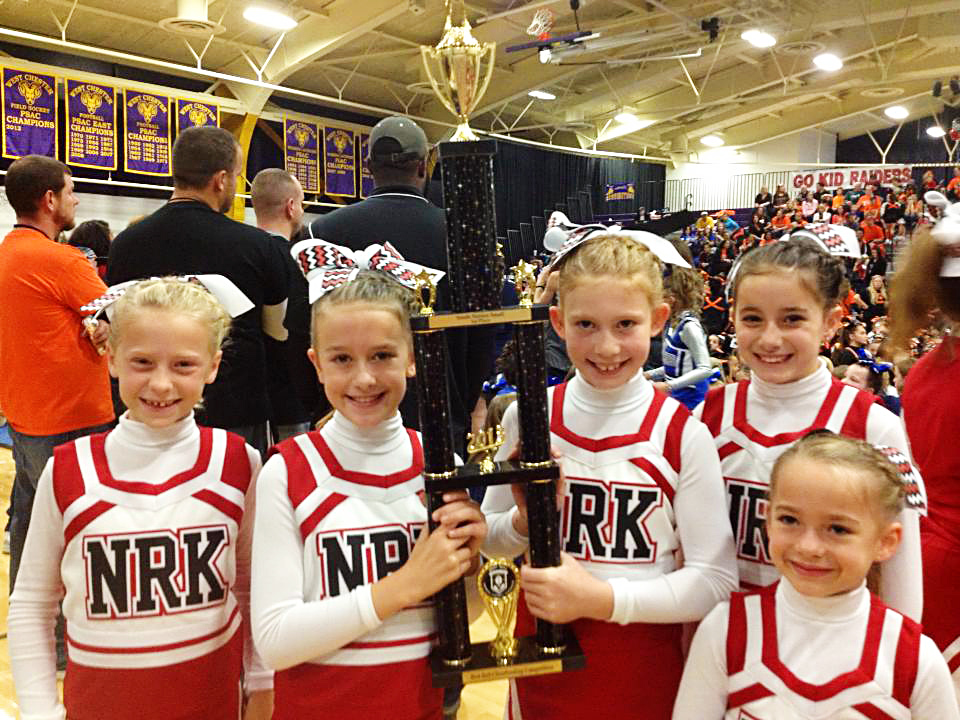 Norchester Red Knights Cheerleading Squad holds First Place Trophy at Bert Bell Cheer Competition