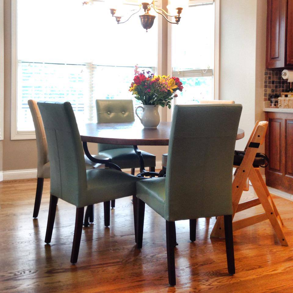 Add in a subtle splash of color with the dining area of the open living room and kitchen concept.