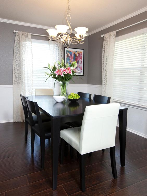 Glossy white trim gives this dining room a clean and bright look. Image: HGTV