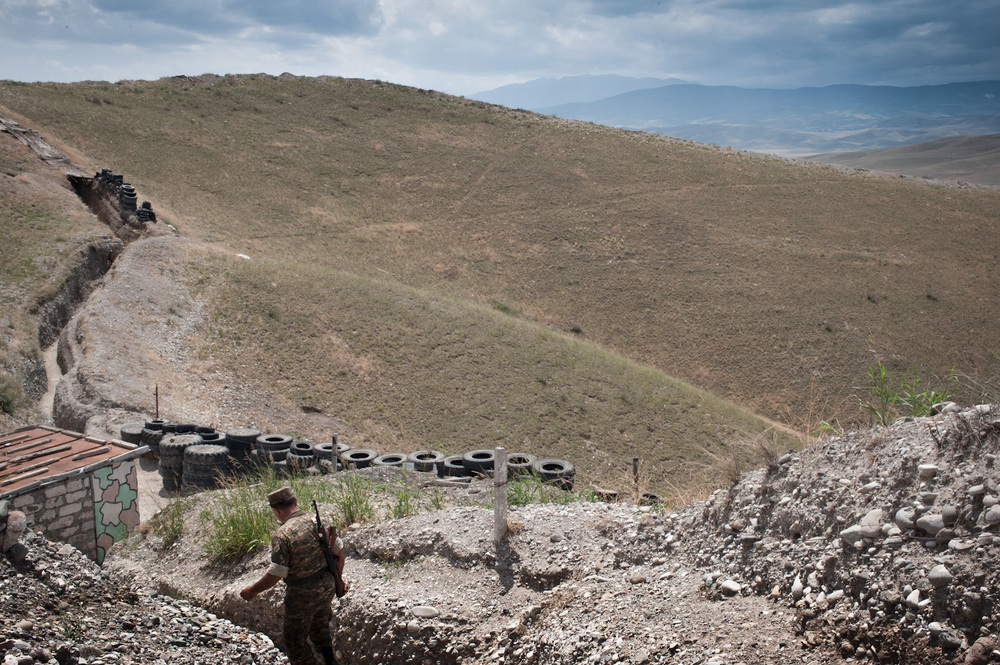 Colonel Alik Sargsyan walks the trenches. He has been a soldier since the Karabakh independence movement began in 1988. He was taken hostage and was a prisoner of war for a year and half before being released.