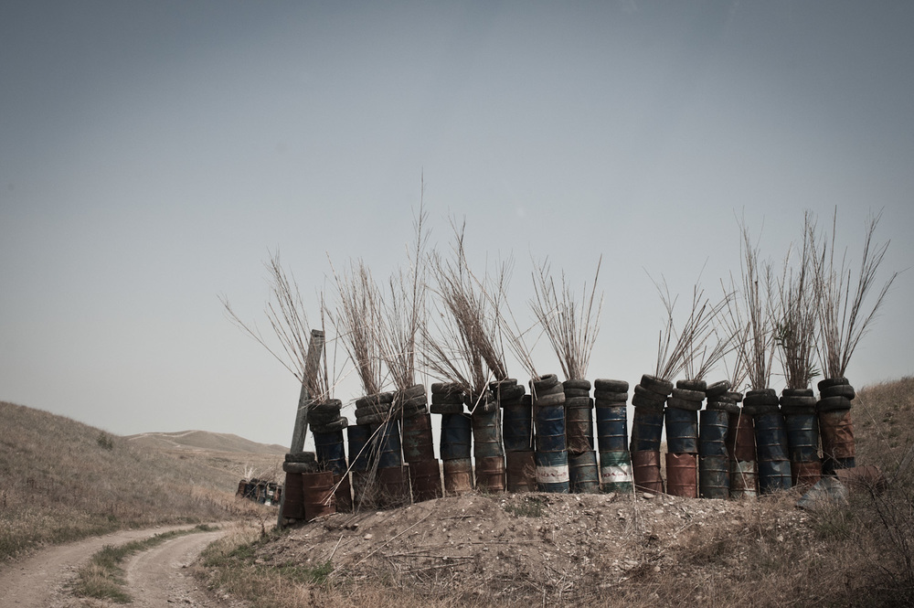 On the exposed portion of the road on the way to the Mataghis frontline is partially fortified against Azerbaijani gunfire by large metal canisters, tires and hay.