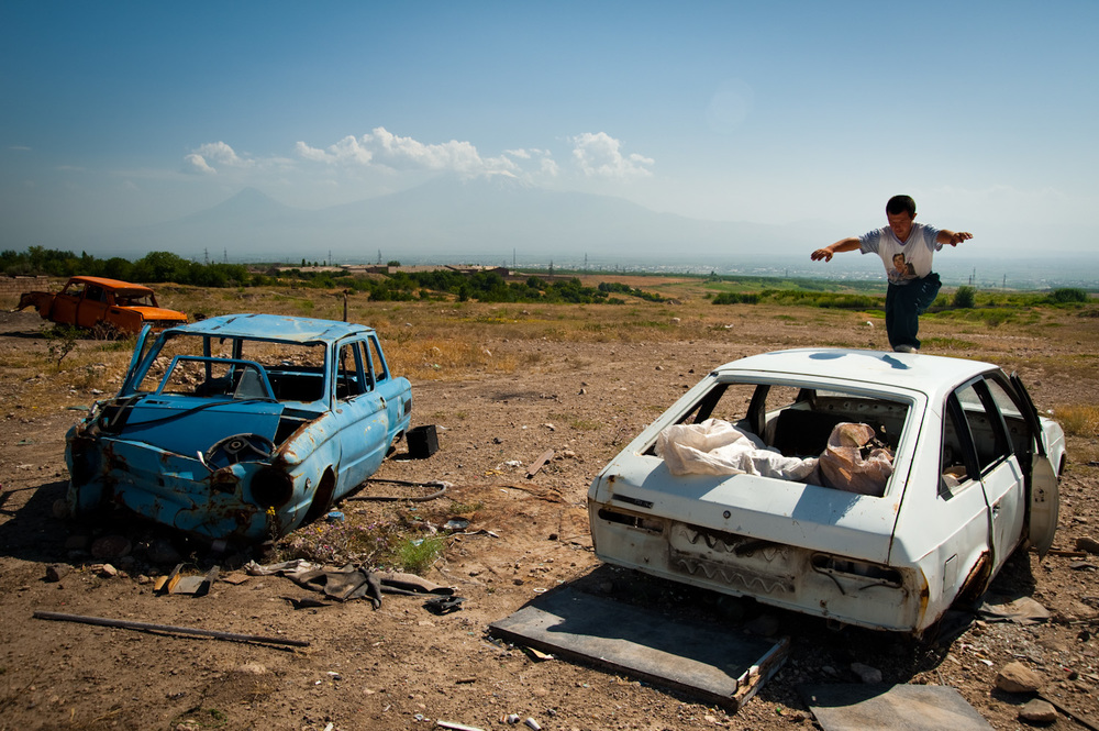 Discarded cars near his shack are Nver's playground. He is Ruzana's eldest and was born with down syndrome. Children with disabilities are often given to orphanages in Armenia. Despite their difficult life, Ruzana chose to keep Nver.