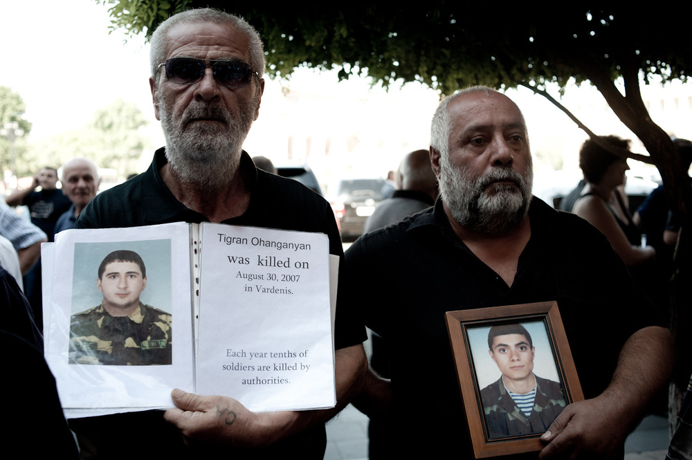 A year after Tigran's death, Tigran's father (left) was attacked twice by a group of men who hit him and warned him to stop protesting his son's death.