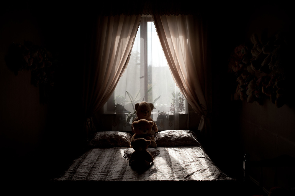 "Araik Avedisyan's bedroom. ""I overheard a conversation my grandchildren were having the other day,"" Anahit recalled, ""my granddaughter Ani asked my grandson Ara what he wants to be when he grows up. Ara said 'a soldier' and Ani responded 'Don't be a soldier, they leave and never come back.'"""