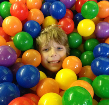 Shane enjoying the ball pit.  (photograph by Caitlin Cassaro)
