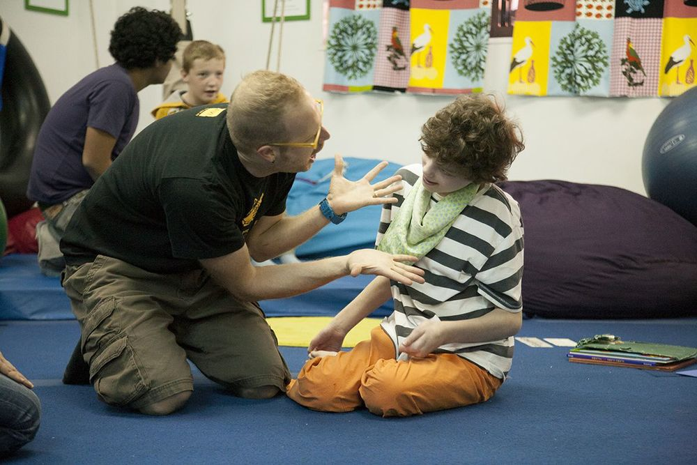 """Music with Jesse was fun for Harry. He has  cerebral palsy ,  sensory integration dysfunction , and  autism spectrum disorder . Although Harry is very social, his unusual behavior makes it difficult for people to connect with him. Jesse's exuberance and genuine interest in Harry was special. Harry greatly enjoyed Jesse's singing and silliness. He enjoyed moving about in a safe space and was curious about the instruments that Jesse would bring to each class. When not in school Harry's social life is lonely. At Extreme Kids Harry can be himself and find folks who celebrate differences."""