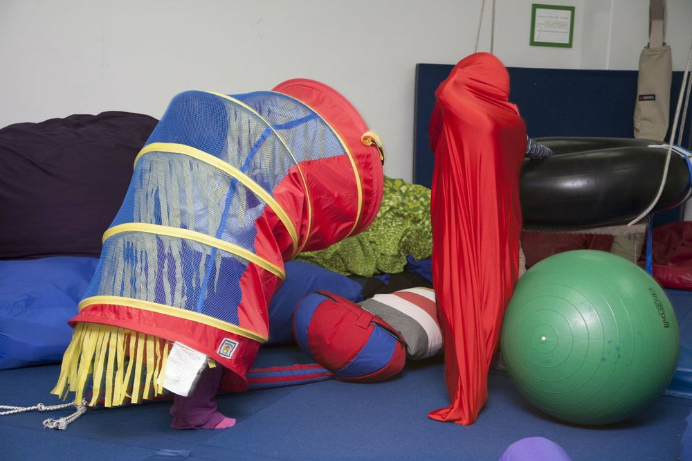 """This is perfect for my son Shane, who has been  diagnosed   with  SPD  and  ADHD . The  ""body glove""  is a quick way to ge  t him back into his   body. I also like that Shane's playmate Fiona is using the    crawl through tunnel  as   an invisible force field. Sometimes unstructured imagin  ative play is just what   Shane needs to assist him in developing stronger  sociali    zation  skills"""
