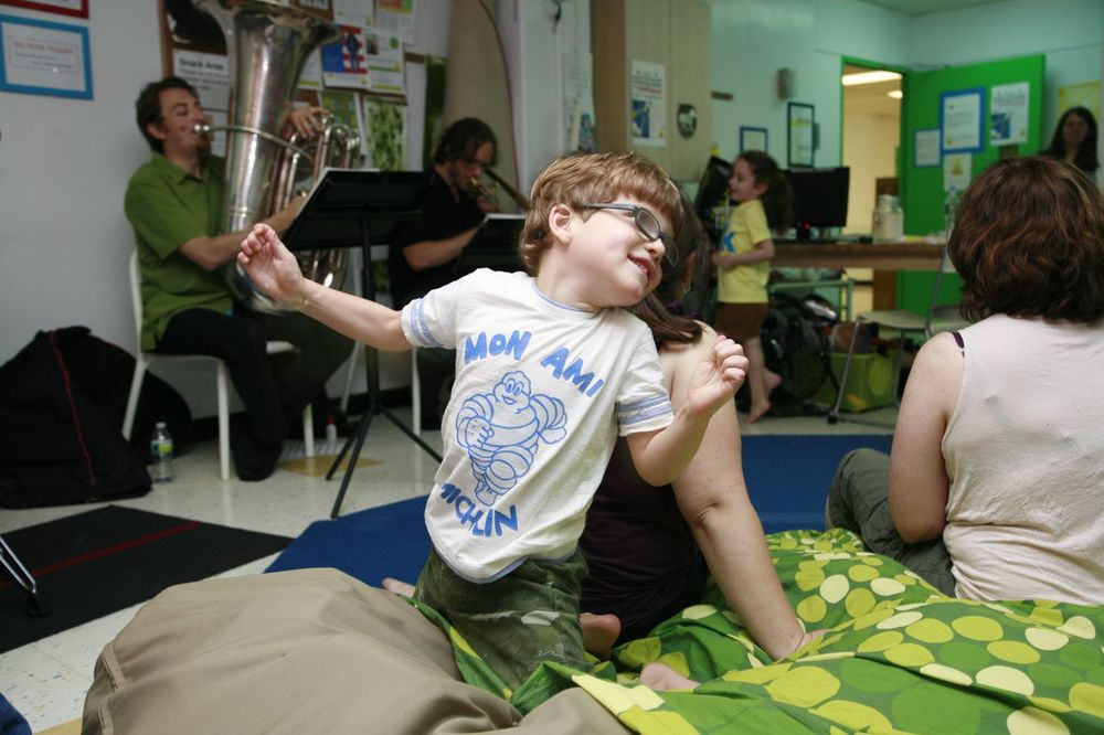 """Our family attends almost every  music event  at Extreme Kids. Hugo, who is  non-verbal,  seems to come alive around live music. We cannot always go to concerts with Hugo in regular venues because he can be loud and doesn't always want to sit still. The environment at Extreme Kids is always comfortable and welcoming to families. Hugo can get his freak on and everyone appreciates his enthusiasm"""