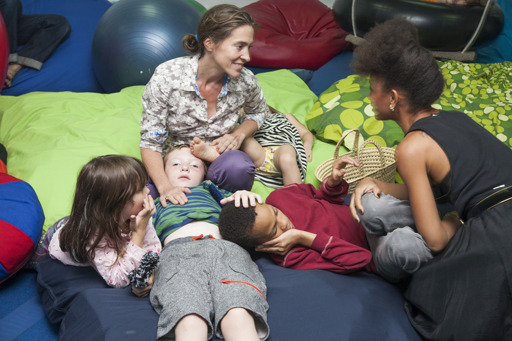""" My hands on Happy's foot and Felix's chest, Felix's hand on Bashir's head, Bashir's hand reaching for his mother's, which is curled around his knee.  I remember Jamila and I talking, so caught up in our conversation that I wasn't aware of how interlinked we all were.  Felix can't talk. He communicates and connects through touch.   A method that is working beautifully at this moment; he is the center of an unconscious human chain. """